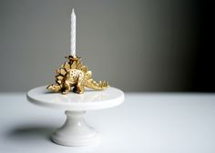DIY candle holder: plastic animal + gold spray paint! (via At Home in Love)