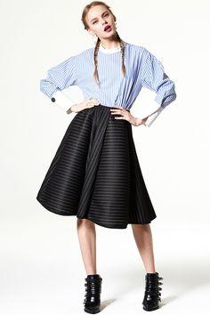 Bloom And Burst Full Skirt Discover the latest fashion trends online at storets.com #Peplum Skirt  #denim shirt   #Color Block Denim Pants
