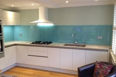 Light Blue glass splashback fitted by Easy Glass Splashbacks showing Socket Cutouts