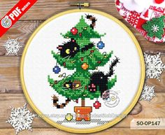 S is for Stitch: 52 Embroidered Alphabet Designs + Charming Projects for Little Ones - Embroidery Design Guide Cat Cross Stitches, Counted Cross Stitch Patterns, Cross Stitch Designs, Cross Stitching, Cross Stitch Embroidery, Xmas Cross Stitch, Cross Stitch Christmas Ornaments, Cross Stitch Cards, Christmas Cross