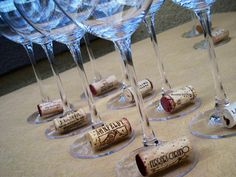 Here's an easy way to identify your glass by simply choosing different wine bottle corks for your glass charms for each of your guests