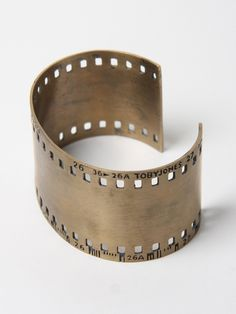35Mm Film Strip Cuff  Self-taught Australian jeweller Toby Jones launched his eponymous label in 2006, establishing a platform midway between art and fashion. Rather than follow seasonal trends, each collection is built around a central theme, reflecting the playful functionality and self-contained aesthetics of everyday life