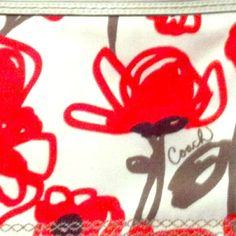 Coach Handbag White and red poppy print. I carried it for less than one season. There is a very small mark on the back, shown in third picture. Coach Bags