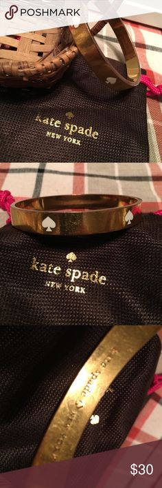 Kate spade white spade bangle goldtone Great Kate spade bangle. Comes with Kate spade dust bag. kate spade Jewelry Bracelets