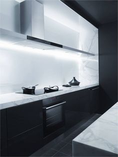 "One fresh cooking space :: KITCHENS :: lovely counter to splash detail for a defined focal point to the work surface. I love the custom hood fan to wall shelf feature and the recessed integrated LED lighting to highlight. ""Kitchen of the Tetsuyas restaurant in Sydney. Black with white marble."" #kitchens"