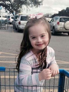 Beautiful little girl with Down syndrome. ♥