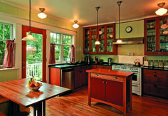 The kitchen was bumped out to repair a muddled, tiny floor plan that resulted when a powder room was added to the house. The 1950s Wedgewood stove is the focal point of the new design; the couple painstakingly painted the beadboard walls themselves.