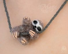 Felt sloth necklace is one of the most popular items in my shop. Extremely cute needle felt sloth makes this kumihimo necklace special and beautiful.  Mini sloth as a small pendant will be suitable for all ages. Note that you can order wool toy sloth on a different color necklace. MATERIALS: my sloth art gifts made from 100% sheep wool. It has polymer clay eyes, claws and wire paws. You wont lost your figurine because it was sewed to braided necklace.  SIZE: 5 cm or 2 in LENGTH of necklace…