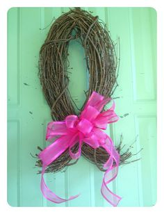 BREAST CANCER DOOR WREATH, MADE OF GRAPE VINE AND RIBBON.