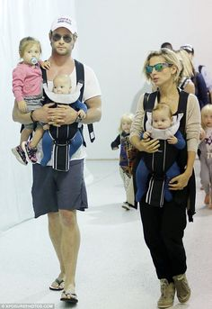 Chris Hemsworth and wife Elsa Pataky juggle their three babies at LAX #dailymail