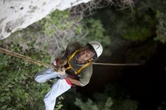 Rappel into the black hole- the belly of an ancient Maya cave.  http://www.cavesbranch.com/belize-black-hole-drop