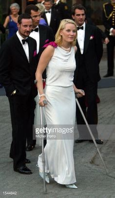 Norwegian Princess Mette Marit is followed by Prince Haakon as she leaves a reception hosted by the government on crutches May 23, 2002 in Trondheim, Norway. The couple are attending the wedding of...