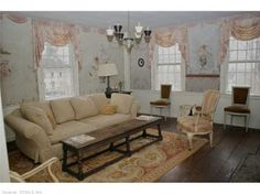 Currently used as a family room - originally the dining room.  Walls have hand painted murals from well known illustrator in 1910.  Find this home on Realtor.com