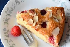 Simple nutty cake with coconut, almond and raspberry. Little tanginess of baked raspberry goes well with sweet. An excellent cake to have with your favorite coffee or tea or as breakfast.
