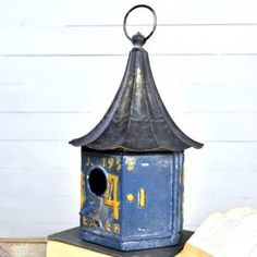 Birdhouse with the design of a blue colored license plate (note the license plate is a reproduction) with a high tin roof. Size: H x D Material: Metal Rustic Wall Hooks, Rustic Walls, Tin Walls, Metal Walls, Antique Farmhouse, Farmhouse Decor, Garden Ornaments, Yard Art, Home Decor Accessories