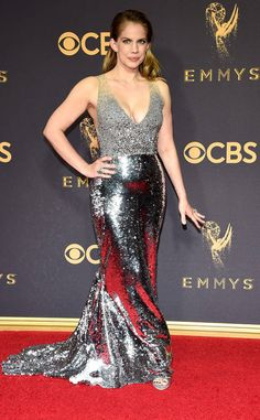 <p>While the <em>Modern Family</em> actress looks undoubtedly sexy, the double slits and high neckline, defined with black sequins, makes this silver ensemble look more costume-y than red-carpet worthy.</p>