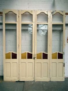 Set of late 19thc room dividers with coloured glass panels{br}h.275 w.239cm{br}£850