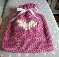 this pattern is for a hot bottle cover, but it could be used as a little gift bag.