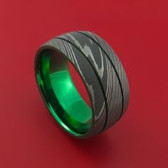 Damascus Steel Ring with Anodized Titanium Interior Sleeve Custom Made