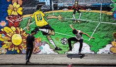 soccer wall painting behind skater guys