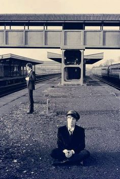 Beatles, John Lennon and Paul McCartney at what looks like a train or underground station. Circa early 1960's