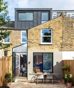 Glass kitchen side extension in London by Neil Dusheiko Architects