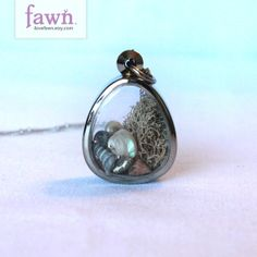 Miniature dome window terrarium locket with moss and sea shells. Necklace for a mermaid