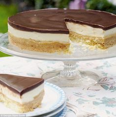 Millionaire's Cheesecake ~ a shortbread base stacked with caramel, creamy cheesecake, and a rich chocolate ganache topping | recipe by Mary Berry from her 2014 book 'Mary Berry Cooks' | via Daily Mail