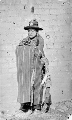 Shoshoni Man in Native Dress Near Brick Wall 1872 by William Henry Jackson (1843-1942)