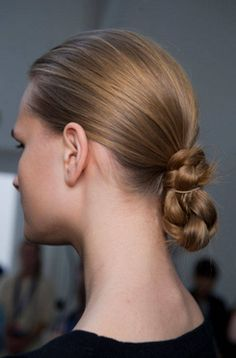 Need Hair Inspo? Here are the latest catwalk styles spring 2014.   There was an equestrian feel to the hair at Margaret Howell with a plaited bun. From a distance it looks low key, but up close the hair is groomed and glossed without so much as a hint of frizz or flyaways.  Use a few GLOSS DROPS to ensure your style stays frizz free.   http://beeverhair.com/uk/finishing/9-gloss-drops.html