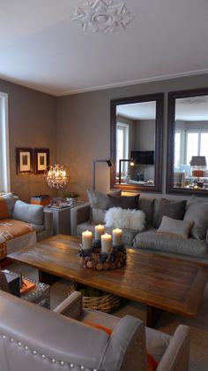 Warm and cozy living room in taupe with a touch of orange - fabrics Loro Piana