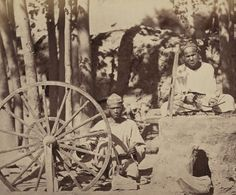 Silk Production. Boy Operating a Stone Spinning Wheel