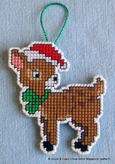 This cute deer pattern from Quick & Easy Magazine was perfect for creating a hangable Christmas tree decoration. I made this one in cross stitch on a 14ct plastic canvas square using whatever stranded cotton threads I had in the right colours. Then I cut very carefully around the stocking leaving one line of canvas intact all round, which I oversewed in white perle.