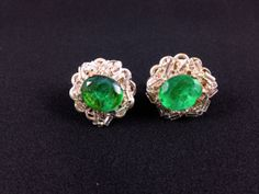 "Lovely vintage Miriam Haskell green glass silver tone clip/screwback earrings measuring 0.75"". Stylish and timelessly elegant, perfect for dressing up a casual outfit or a more formal ensemble. The earrings are in great condition."