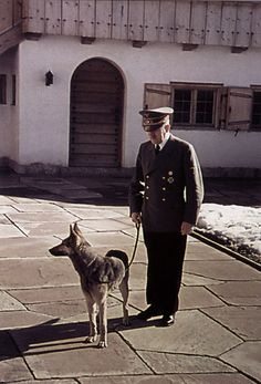 Adolf Hitler with Blondi on the Berghof terrace.