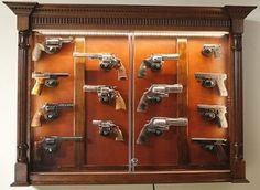 We offer a wide range of custom crafted display cabinets for pistols and knives as well as long guns. Our pistol display cases feature double locks for all guns as well as bullet proof polycarbonete glass to provide maximum security for your collection. Weapon Storage, Gun Storage, Antique Display Cabinets, Gun Rooms, Woodworking Inspiration, Woodworking Projects, Gun Cases, Custom Guns, Displaying Collections