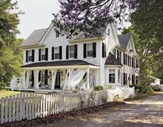 I really like the use of sheer curtains on porches.  Creates a dreamy atmosphere.