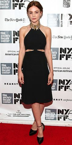 CAREY MULLIGAN The newly-brunette star shows off her dark hair in a black Alexander McQueen halter dress featuring a gold-embroidered neckline and cutouts at the waist at the premiere of Inside Llewyn Davis premiere in N.Y.C.