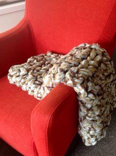 Arm knitting a throw blanket with super chunky yarn.  www.thatlabel.com.au