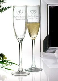 Two hearts intertwined to become one. Toast the beginning of your new life together with this special keepsake flute set and give them to your bridal party as well! Sold as a set of two, toasting flutes are etched with double hearts and can be personalized with two lines of text; 20 characters per line, including spaces. 5.75 oz. capacity. Measures 8.34 inches in height.