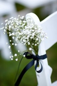 outdoor wedding aisle. baby's breath ties to chairs with colorful ribbon. Or, you know, queen ann's lace for free.