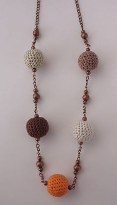 Necklace of crocheted balls and copper beads by DreamList on Etsy, $19.90