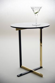 Peasant Table in oxidized and polished brass designed by Brad Ascalon. Perfect place to rest your martini.