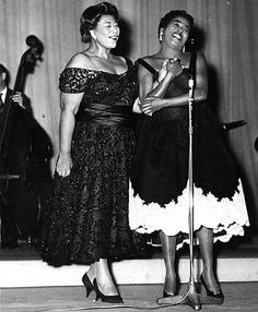 Ella Fitzgerald and Sarah Vaughan.  Powerful.... these ladies could the earth with their voices!!!!