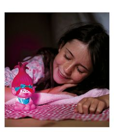 This 3D Trolls Poppy Colour Changing Light magically brings your favourite character to life! The battery operated nightlight is fully portable so Poppy can be taken with you wherever you go, whether it's a family holiday or a sleepover at a friend's. Cool to touch, with an easy on / off switch, this is a definite must have for any Trolls fan.