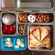 My son tried pistachios for the first time and said he loved it, but left most of it . Today's practice lunch: cheese pizza on flat bread, GF pretzels + yogurt-covered pretzel, grape tomatoes + Ranch, pear cubes, and pistachios. He also left all the tomatoes . #planetbox #planetboxlunches #schoollunch