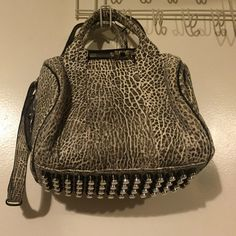 Alexander Wang Rockie Textured leather Alexander Wang Rockie bag. The bag is in great condition but the cross body strap is damaged, as seen in the picture. Alexander Wang Bags