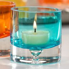 """Bubble glass tealight holders in turquoise.     Product: Tealight candleholderConstruction Material: Bubble glassColor: Turquoise Accommodates: 1 Tealight candle - not includedDimensions: 2.75"""" H x 2.75"""" Diameter"""