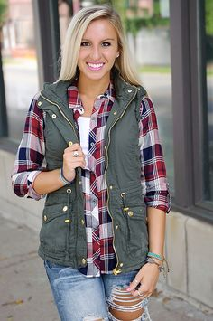 This awesome cargo vest is lined with faux fur and has a removable hood, front pockets and tie waist.  Olive