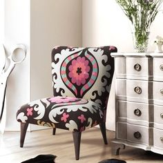 Turquoise and Pink Chair - don't know why but I love this - doesn't look comfy or go with anything else in my house...maybe it can go in my dream closet!